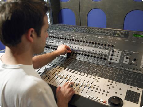 Man Training on Sound Board in Studio